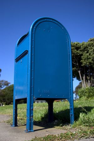 write off: Delivery box for the US mail. Looking very blue against the sky.