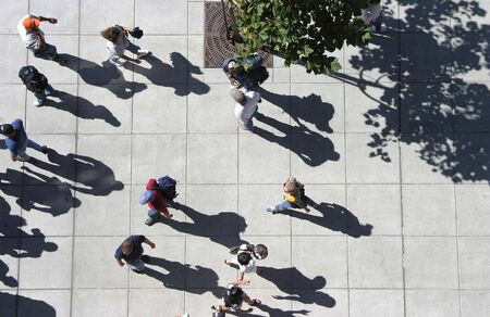 baseball crowd: A birds eye view of a crowd of people strolling down a sidewalk. Stock Photo
