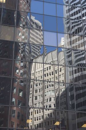 Buildings reflected in the glass face of a building. Reklamní fotografie