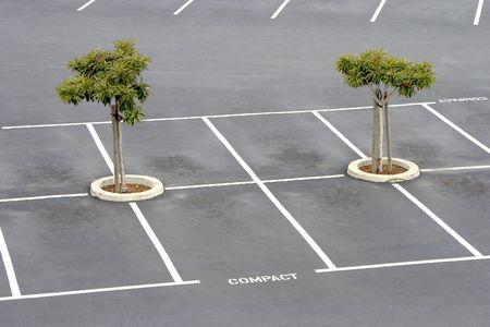 Empty parking spaces await commuters. Stock fotó