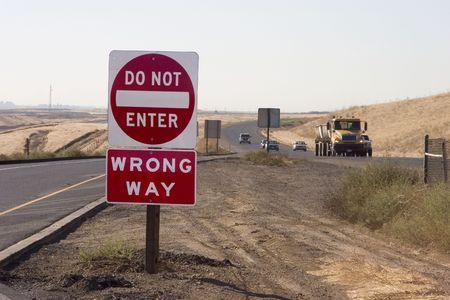 A Wrong Way sign gives warning.