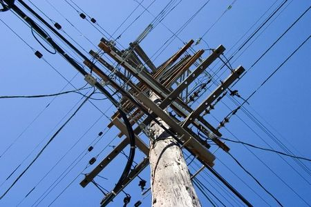 Looking up at a very tall power poll.