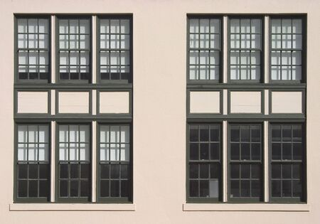 Large windows on the side of an old industrial building.