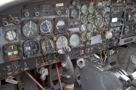 The various switches and dials of a aircraft cockpit.