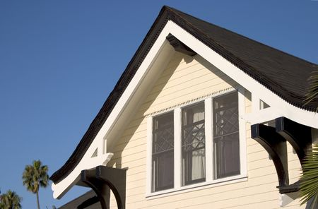 Peeked craftsmen style roof with windows on it's face. Foto de archivo