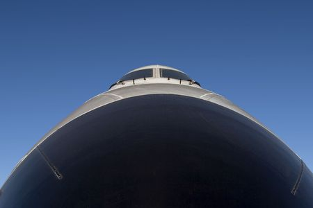 Looking up the nose of a 747 jumbo jet.