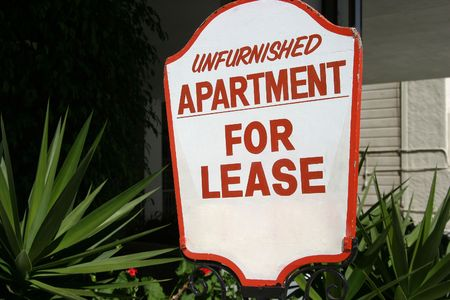 unfurnished: A sign advertising an unfurnished apartment for lease.