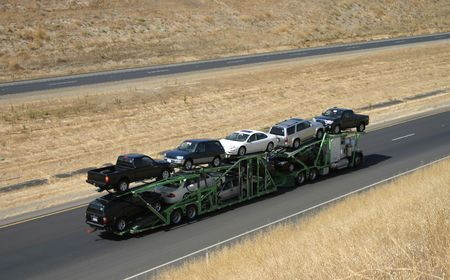 waggon: A large truck delivers new cars via highway. Stock Photo