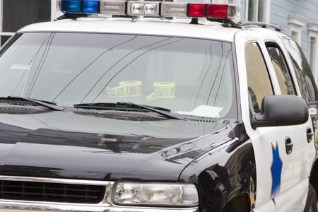 A close view of a police car at a crime scene.