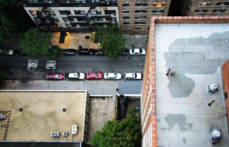 the height of a rim: A jumper�s view of the street below.