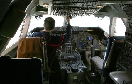 A pilot runs through a systems check prior to take-off in a 747 jumbo jet.
