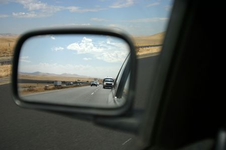 Driver-side perspective of the rear-view mirror.