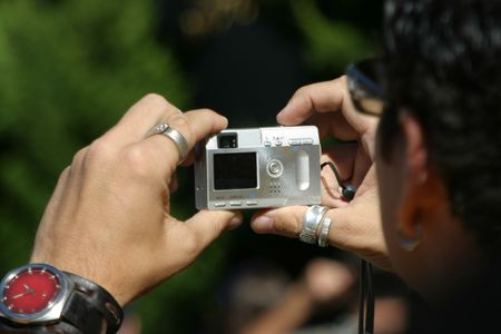 snappy: A man snaps off another shot with his pocket digital camera.