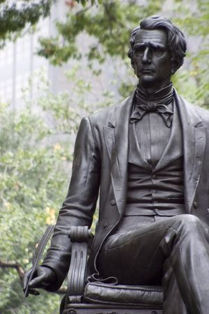 The statue of a writer in Madison Square park, New York City.