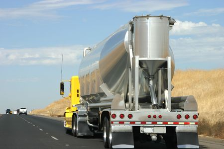 tanker type: A tanker truck transports some type of liquid to who knows where.