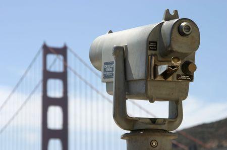 A coin operated telescope aimed at San Francisco's Golden Gate Bridge. Banco de Imagens