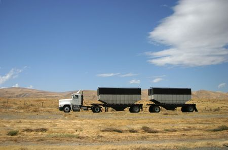 A tractor-trailer hauls some stuff down the highway. Stock Photo - 397010
