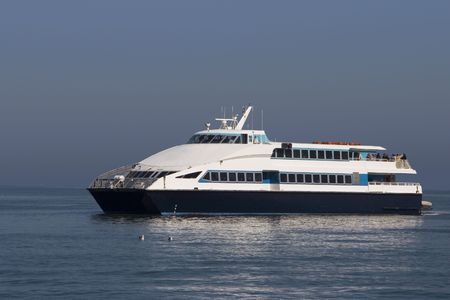 A ferry boat pulling up to San Francisco's Ferry Building.