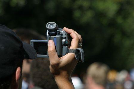 A man videotapes an event. Stock fotó