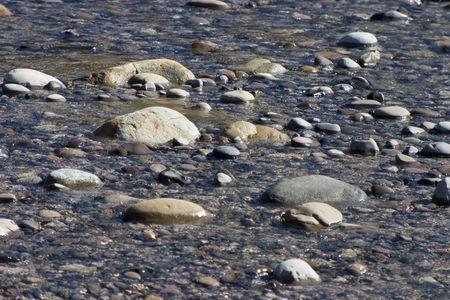 polished: The polished stones of a stream.