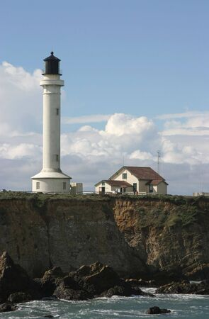 A lighthouse on the rugged cliffs of Point Arena, California. photo