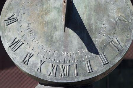 A sundial shadowing the time. Фото со стока