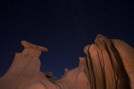 Badlands hoodos formations on a starry night Stock fotó