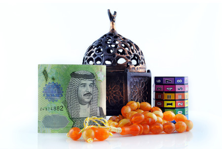 bahrain money: Bahrain currency with Rosary - isolated