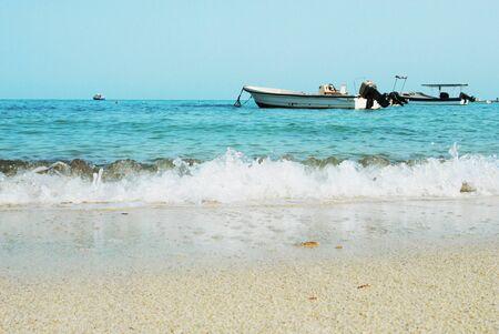 Fishermen boats inside the sea at sunny day