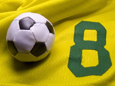 photo of the soccer ball over nuber eight uniform photo