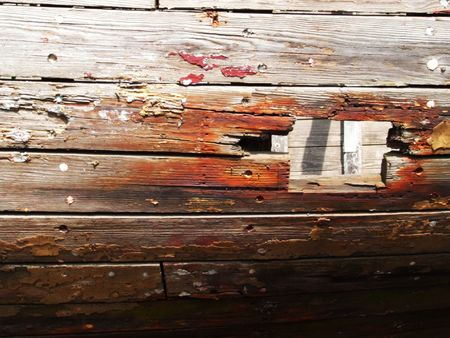 photo of the old boat with damaged board photo