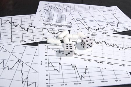 checkout line: photo of drugs and dice on charts