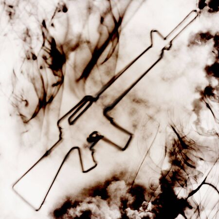 illustartion of automatic gun in the smoke photo