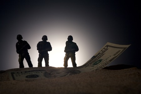 power rangers: Silhouette of military soldiers on money background