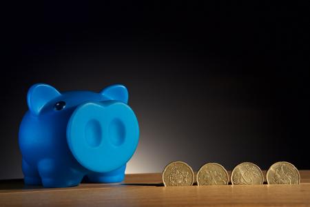 piggy bank on a wooden base black background