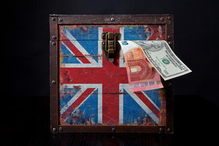 skepticism: euro and american dollar on British flag Stock Photo