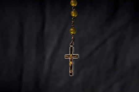rosary on blackground with free space
