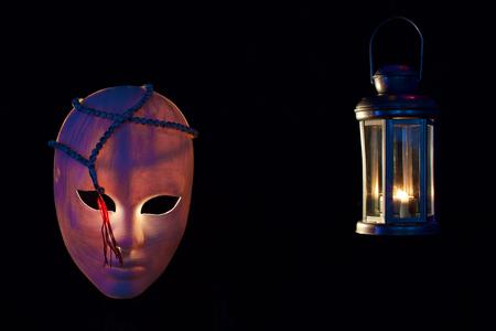 concept of terrorism.mask, muslim rosary and lantern on dark Stock Photo