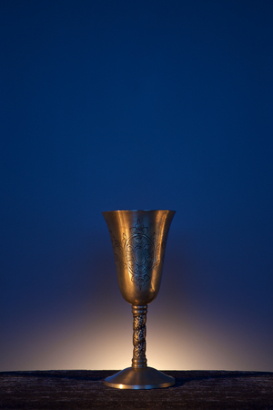 Vintage goblet for wine on blue background
