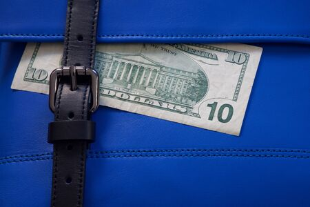 leather texture: blue leather bag stitching with black buckle and money
