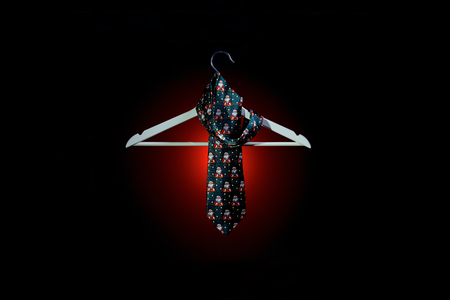 Christmas tie and coat hanger. End of the Year concept. Stock Photo