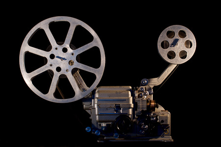 movie projector on black background Imagens