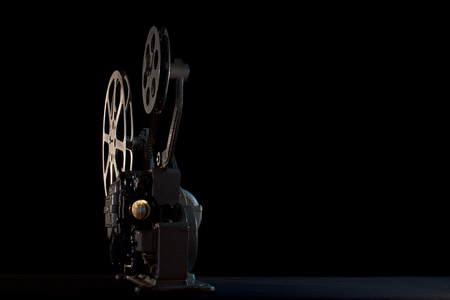 movie projector on black background 스톡 콘텐츠