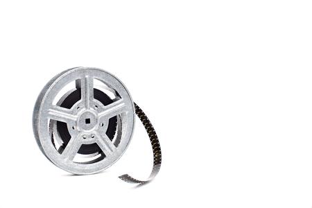 metal old movie film reel on white background