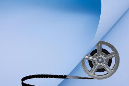 Movie film reel on blue papper