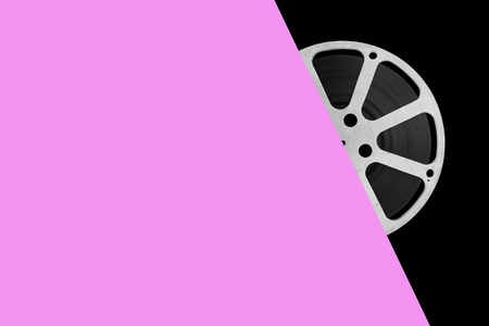 Movie film reel on color background