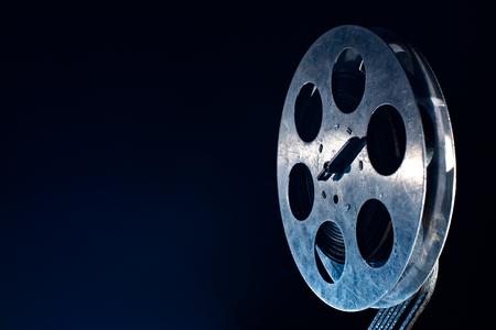 Movie film reel on dark Reklamní fotografie