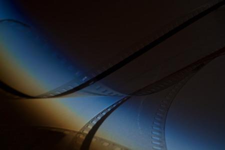 Old film strip on dark background Reklamní fotografie