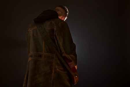 Romantic gothic boy playing guitar Reklamní fotografie