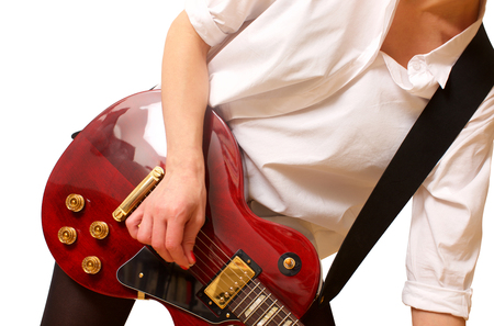 Young woman playing the guitar on white Stock Photo